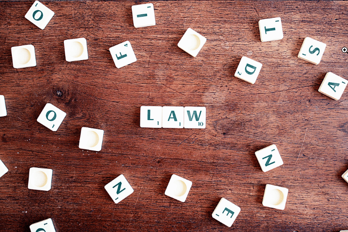 scrabble tiles forming the word law